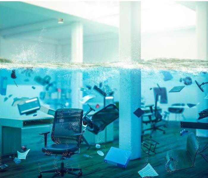 office furniture and supplies submerged under water in an office room
